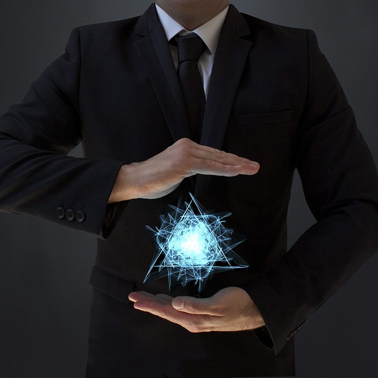 Mysterious businessman holding triangle plasma in hands.